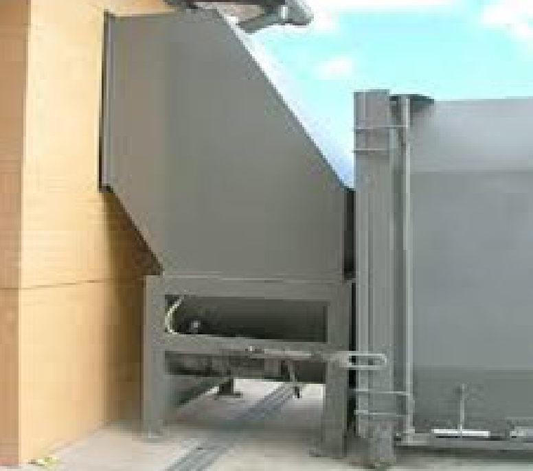 Auger Compactor with Chute